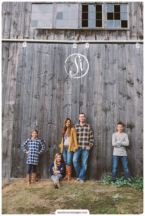 A family poses by a barn in lancaster, PA
