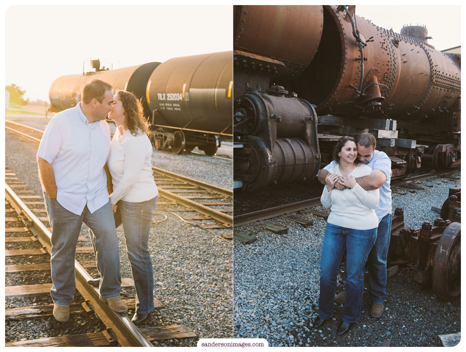 Engagement Portraits at the strasburg railroad, old train cars in the background of a snuggly couple